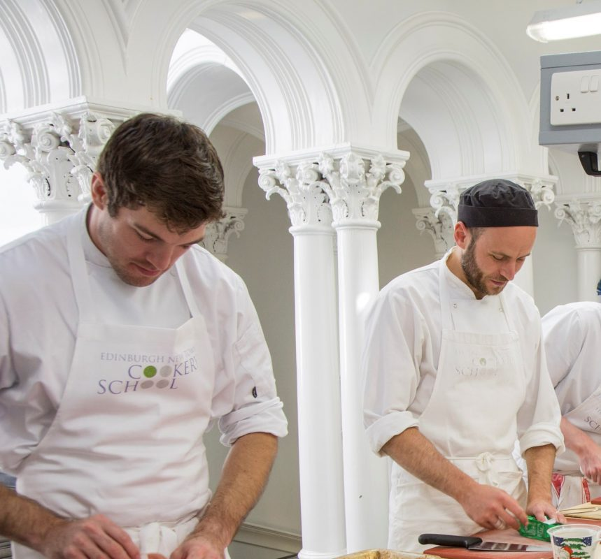 Professional cook school chefs preparing food during cookery course