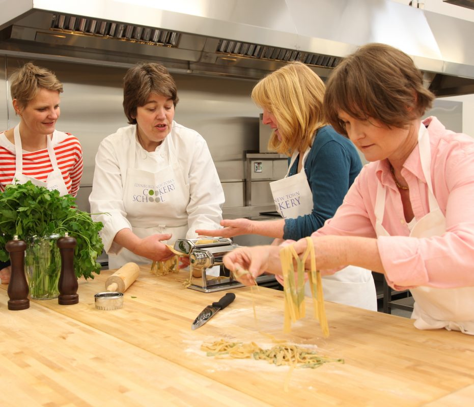 Fiona Burrell principal of Edinburgh New Town Cookery School teaches students to cook on the Italian cookery course